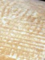 Фото 53. Фрагмент блока пирамиды со следами от циновки
