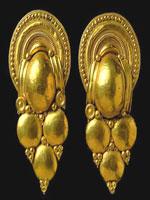 Этрусские серьги в форме винограда, найденные в одной из гробниц в городе Вульчи