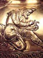 Скиф на конце золотой гривны из кургана Куль-Оба