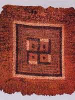 Свастика на тибетском коврике для медитации