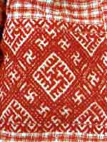 Свастика на фрагменте женской рубахи. Нач. 20 века. Тарногский район